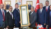 Kamu-Sen'den MHP il başkanı Yüksel'e FETİH suresi tablosu